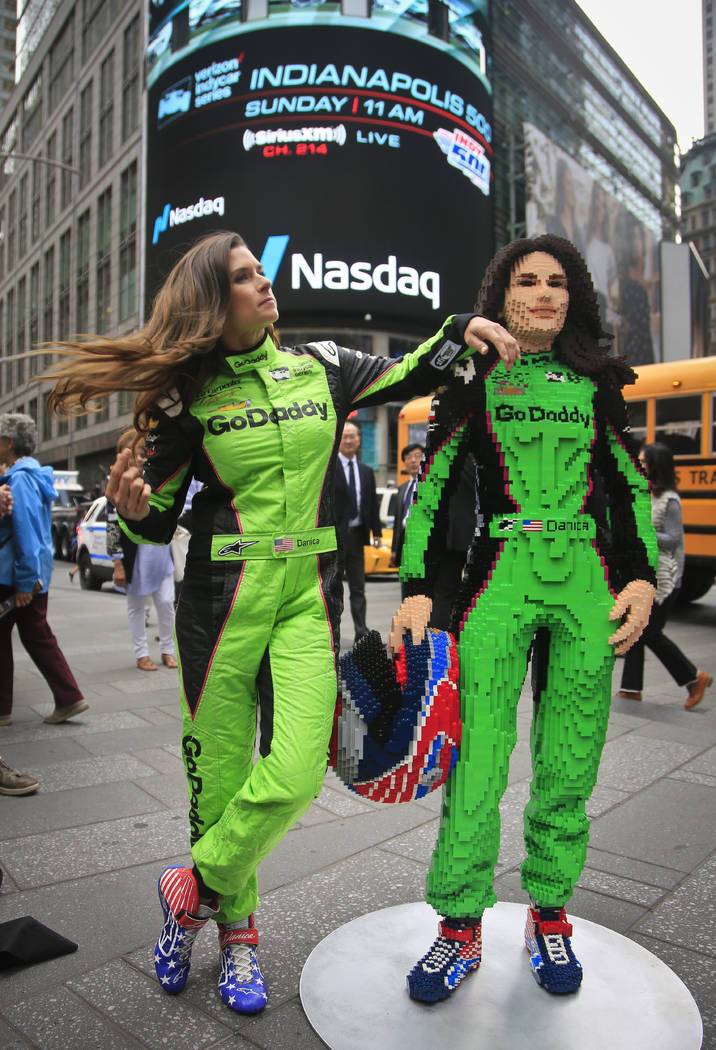 Race driver Danica Patrick, left, pose with a life-size Lego statue creation of herself, Tuesday, May 22, 2018, in New York. Lego master builder Chris Steininger says it took him 200 hours to buil ...