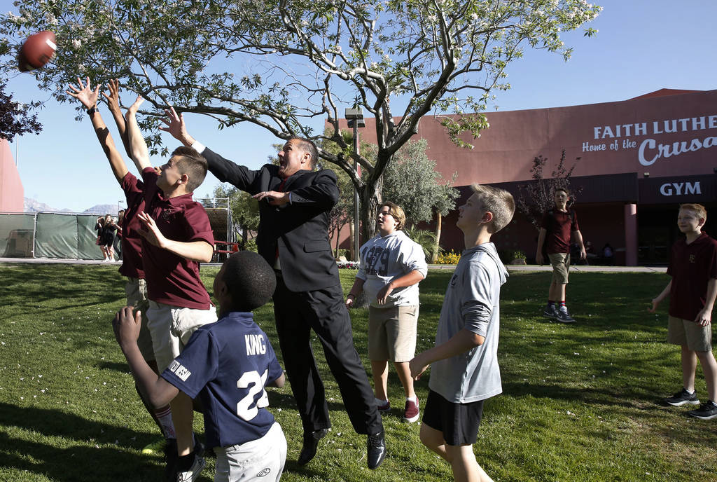 Dr. Steve Buuck, CEO and administrator of Faith Lutheran Middle and High School, plays football with his students on Wednesday, May 23, 2018, in Las Vegas. Bizuayehu Tesfaye/Las Vegas Review-Jour ...