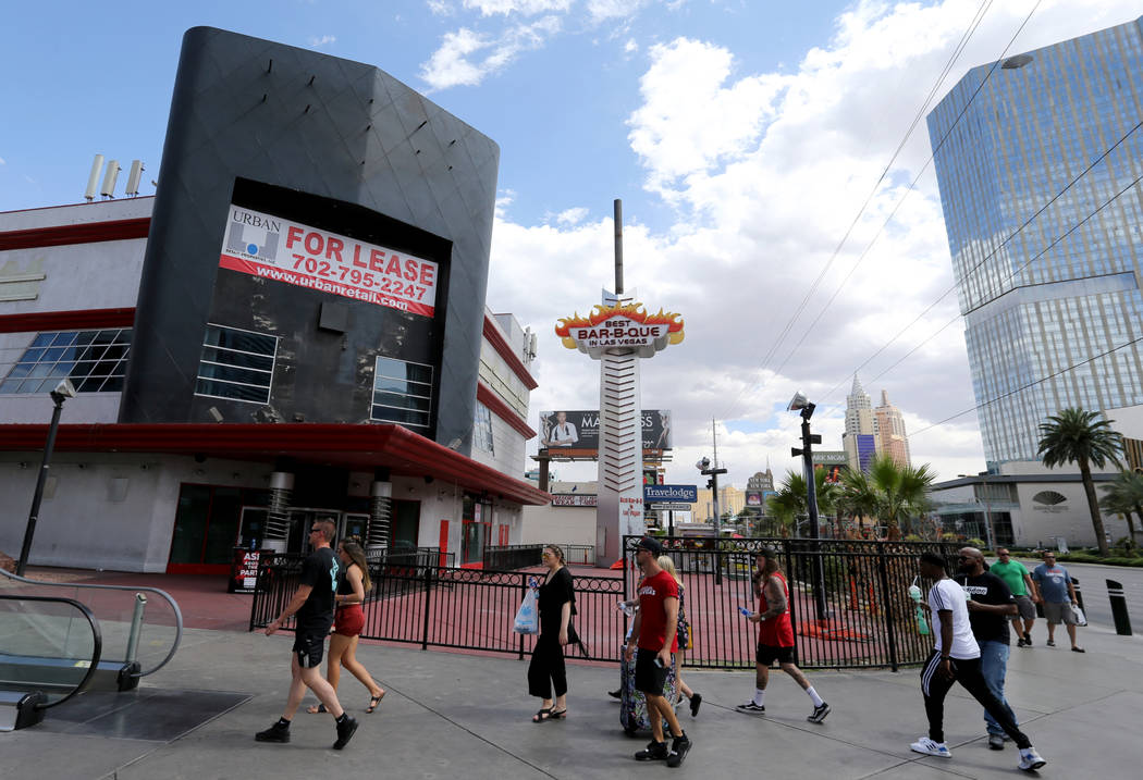 People walk on the Strip near Harmon Avenue past a 16-acre piece of property that is for sale Tuesday, May 22, 2018. K.M. Cannon Las Vegas Review-Journal @KMCannonPhoto