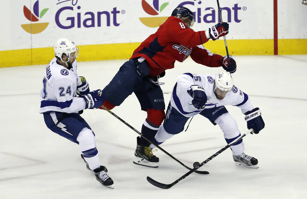 Washington Capitals left wing Alex Ovechkin (8), from Russia, hits Tampa Bay Lightning defenseman Dan Girardi (5) with Lightning right wing Ryan Callahan (24) nearby during the first period of Gam ...