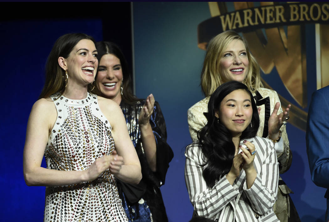"From left, Anne Hathaway, Sandra Bullock, Cate Blanchett, top, and Awkwafina, cast members in the upcoming film ""Ocean's 8,"" stand together onstage during the Warner Bros. Pictures prese ..."