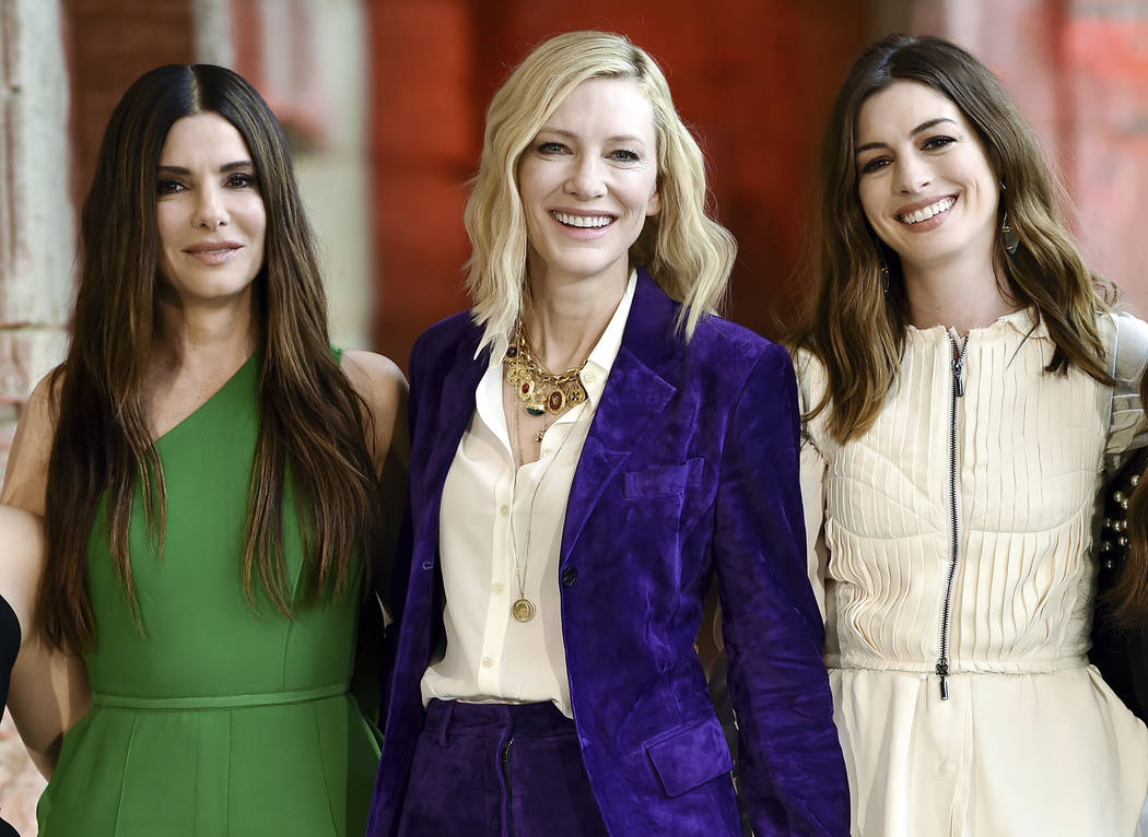 "Actors Sandra Bullock, from left, Cate Blanchett and Anne Hathaway pose together during the ""Ocean's 8"" cast photocall at the Temple of Dendur in the Metropolitan Museum of Art on Tuesda ..."