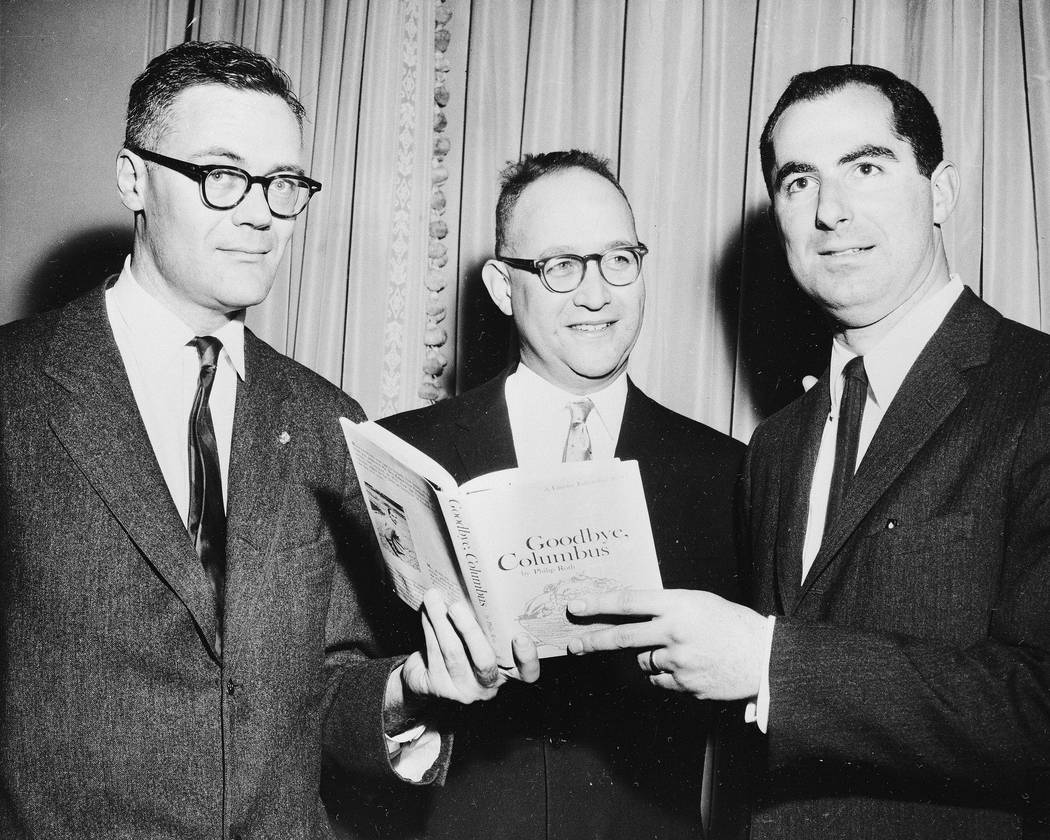 FILE - In this March 24, 1960 file photo, the three winners of the National Book Award, Robert Lowell, from left, awarded for the most distinguished book of poetry, Richard Ellmann, won in the non ...