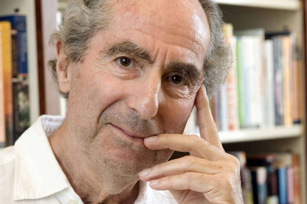 FILE - In this Sept. 8, 2008, file photo, author Philip Roth poses for a photo in the offices of his publisher, Houghton Mifflin, in New York. Roth, prize-winning novelist and fearless narrator of ...