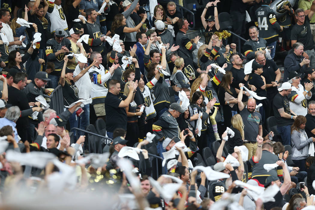 Fans celebrates a goal by Vegas Golden Knights center William Karlsson (71) during the first period in Game 4 of the Western Conference Final at T-Mobile Arena in Las Vegas, Friday, May 18, 2018. ...
