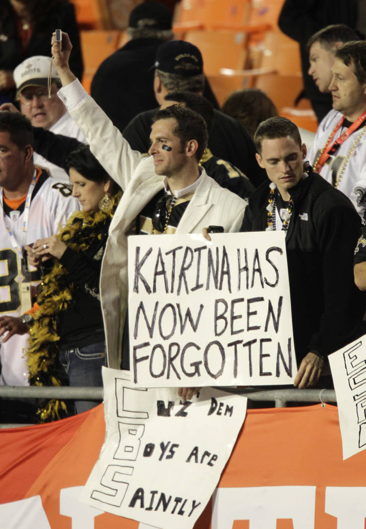 "Fans hold a sign that reads ""Katrina has now been forgotten"", after the NFL Super Bowl XLIV football game between the Indianapolis Colts and New Orleans Saints in Miami, Sunday, Feb. 7, ..."
