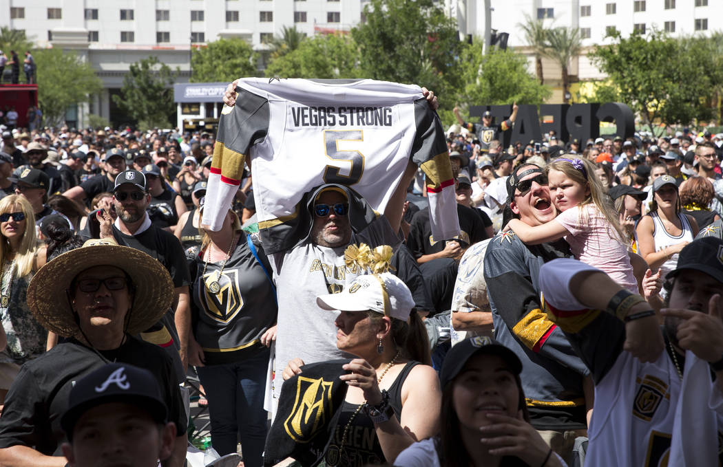 A Golden Knights fan holds up a jersey after the Knights defeated the Winnipeg Jets 2-1 during a watch party for Game 5 of the Western Conference Finals at Toshiba Plaza in Las Vegas on Sunday, Ma ...