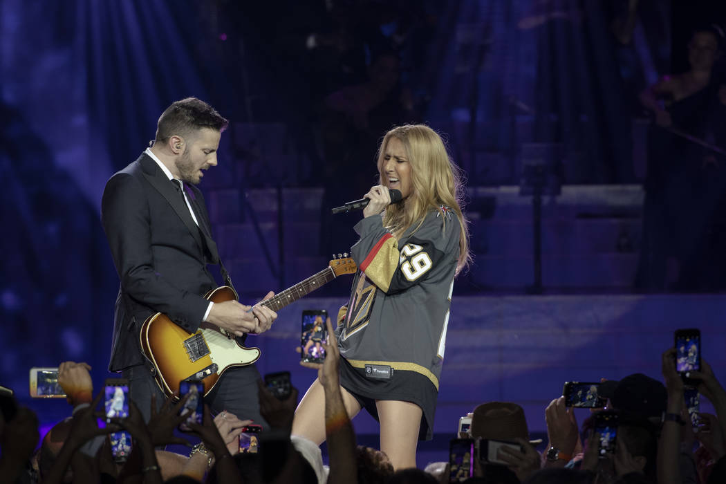 Celine Dion, shown with guitarist Kaven Girouard, sports a Marc-Andre Fleury Vegas Golden Knights jersey during her return to the Colosseum at Caesars Palace after minor ear surgery on Tuesday, Ma ...