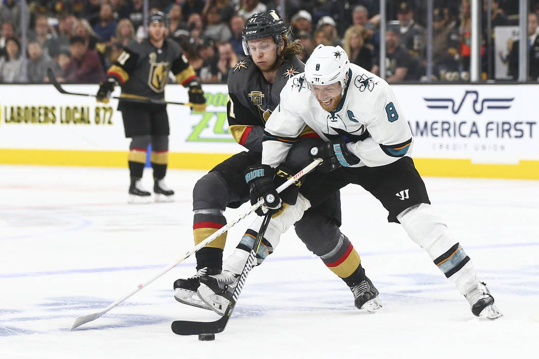 Golden Knights center William Karlsson (71) and San Jose Sharks center Joe Pavelski (8) battle for the puck during the first overtime period of Game 2 of an NHL hockey second-round playoff series ...