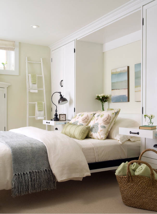 Houzz When guests arrive, this family room is quickly converted to a welcoming guest room with a pull-down Murphy bed. Night table trays pull out from the custom built-ins to hold a lamp or glass ...
