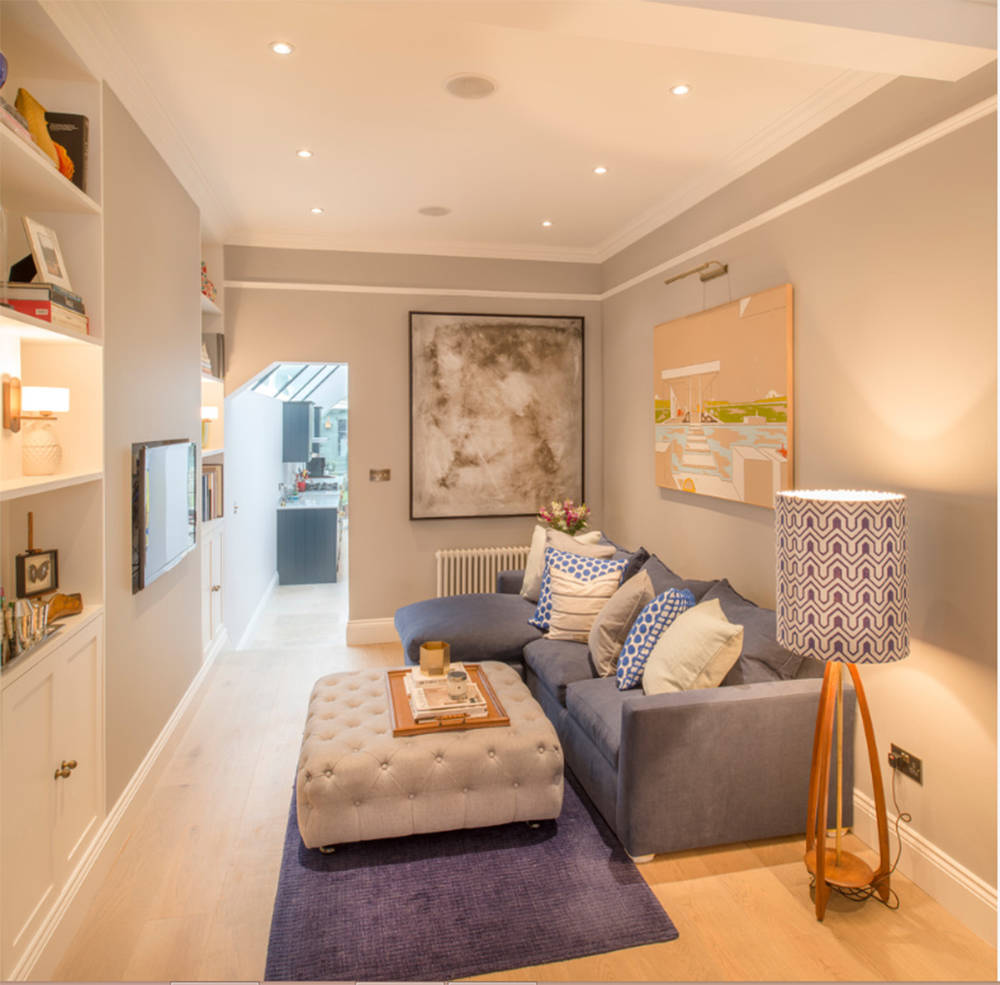 """HOUZZ This tiny living space provides lots of seating, and the ottoman works as a """"table"""" and extra seating."""