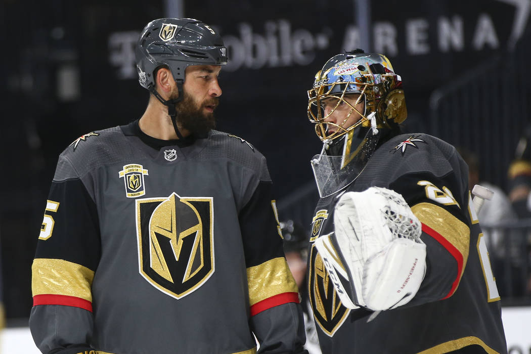 Golden Knights goaltender Marc-Andre Fleury (29) talks with Golden Knights defenseman Deryk Engelland (5) during a break during the second period of Game 2 of an NHL hockey second-round playoff se ...