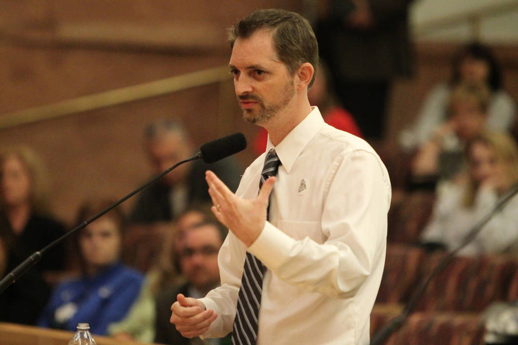 No Kill Las Vegas organization president Bryce Henderson presents details for their no kill project during a Clark County Commission meeting inside the Clark County Commissioner chambers in Las Ve ...
