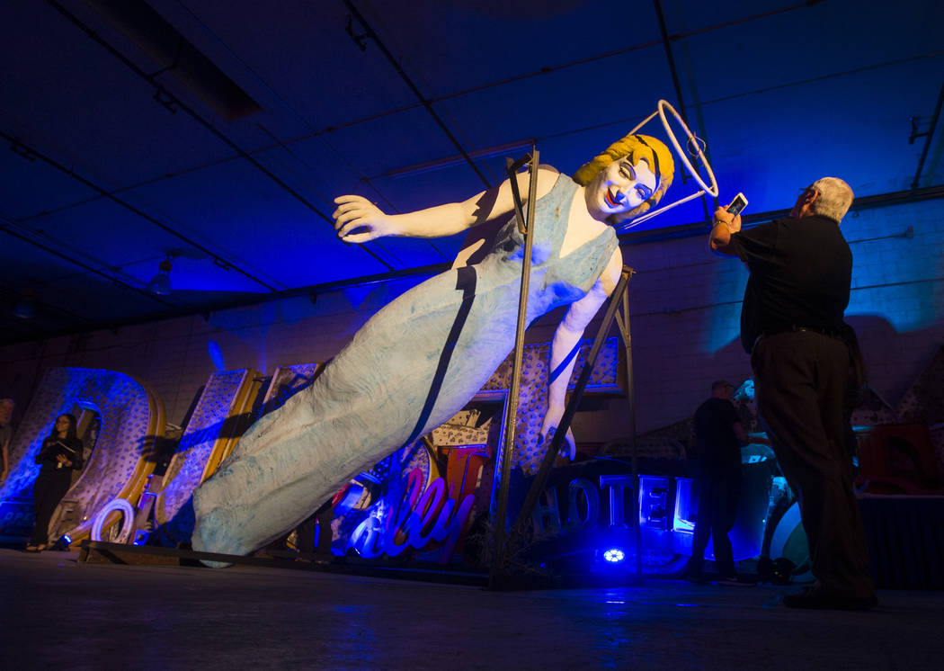 Mike Cohen takes a photo of the Blue Angel statue, designed by Betty Willis, at the Neon Museum's Ne10 Studio in Las Vegas on Thursday, May 24, 2018. The statue came down from its perch in March o ...