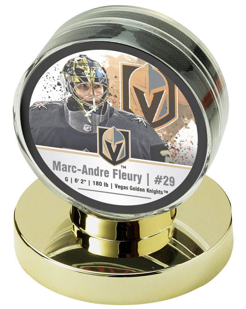 A Marc-Andre Fleury Vegas Golden Knights commemorative hockey puck, part of a four-puck set being sold by Nikco Sports Memorabilia, with a percentage of the sales going to the Golden Knights Found ...