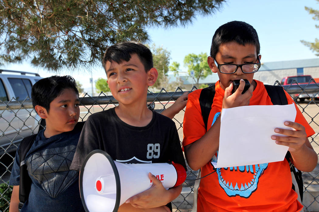 Benjamin Mijarez, 10, speaks about grievances over CCSD budget cuts and other issues as Diego Moreno, 10, from left, and Adrian Hinojosa, 9, listen during a town hall outside of Stanford Elementar ...