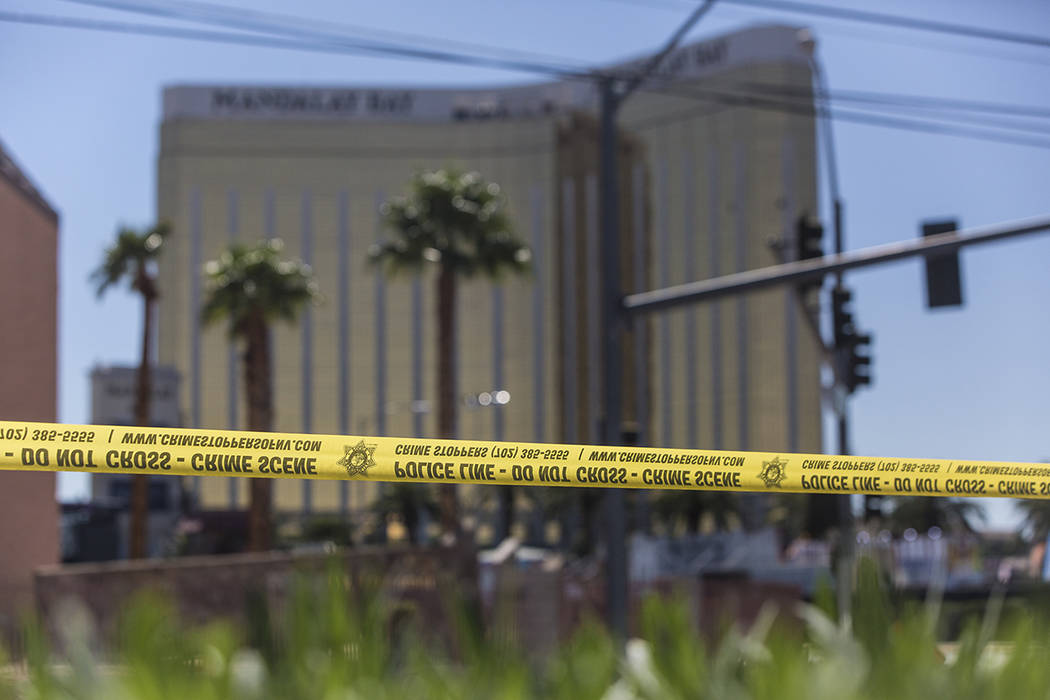 Police tape blocks a section of West Reno Avenue and Las Vegas Boulevard on Monday, October 2, 2017, outside the Mandalay Bay hotel/casino, in Las Vegas. Benjamin Hager Las Vegas Review-Journal @ ...