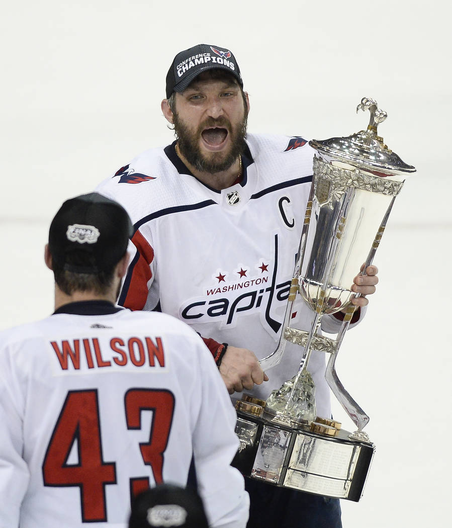 Washington Capitals right wing Tom Wilson (43) watches as left wing Alex  Ovechkin celebrates 8202d577bc10