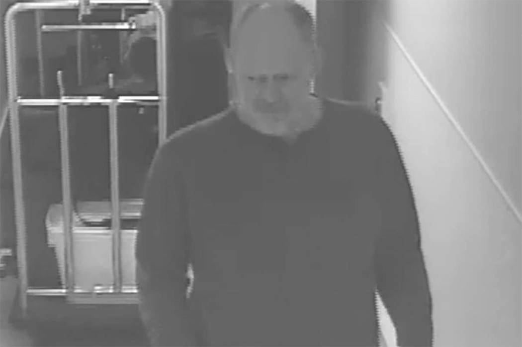 Las Vegas gunman Stephen Paddock at Mandalay Bay before the shooting at the Route 91 Harvest music festival shooting on Oct. 1, 2017. Behind him is a bellman's cart with luggage and a plastic bin. ...