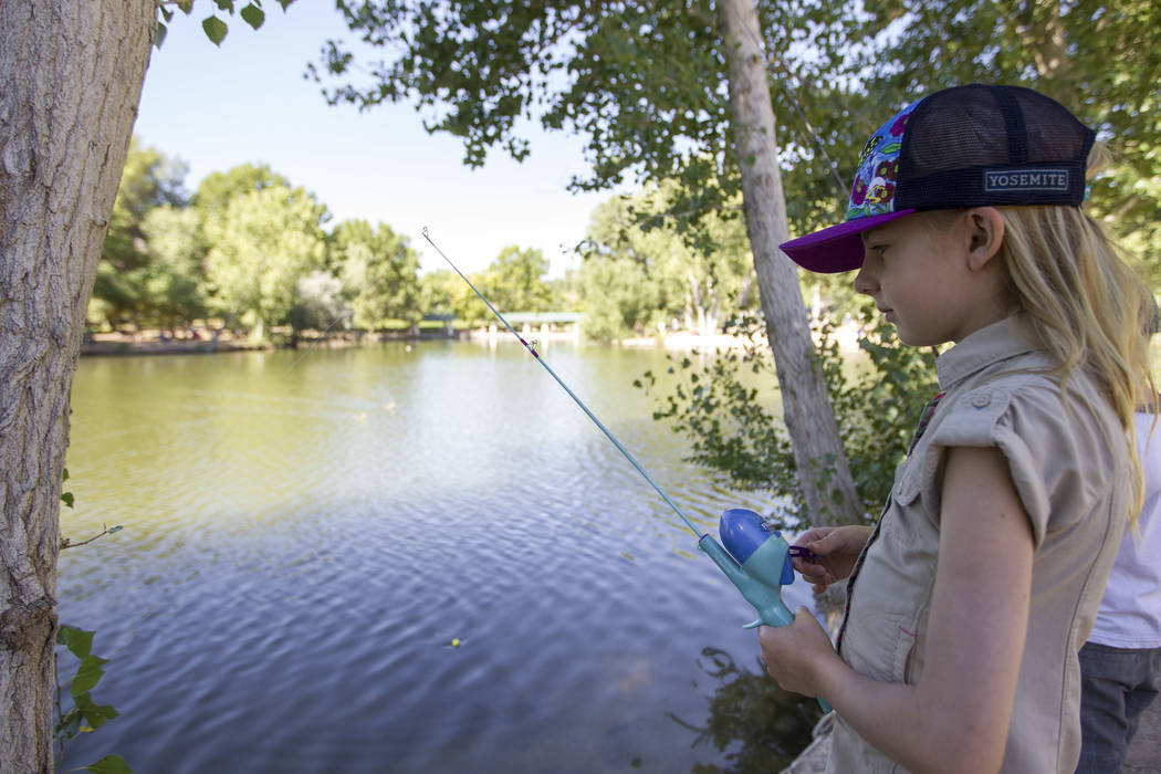 Eight-year-old Emma Polenske waits for fish to bite during a fishing derby held by the Las Vegas City Council at Floyd Lamb Park at Tule Springs in northwest Las Vegas on Saturday, June 10, 2017. ...