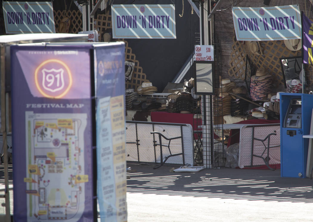 The Down N Dirty Hat Company booth sits frozen in time at the Route 91 Harvest shooting site at Las Vegas Village festival grounds, Tuesday, Oct. 31, 2017. Richard Brian Las Vegas Review-Journal @ ...