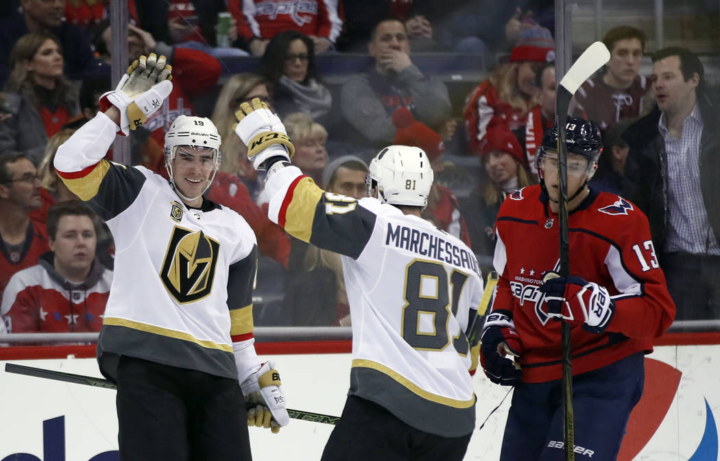 Vegas Golden Knights right wing Reilly Smith, left, and center Jonathan Marchessault celebrate Smith's goal with Washington Capitals left wing Jakub Vrana (13), from the Czech Republic, nearby in ...