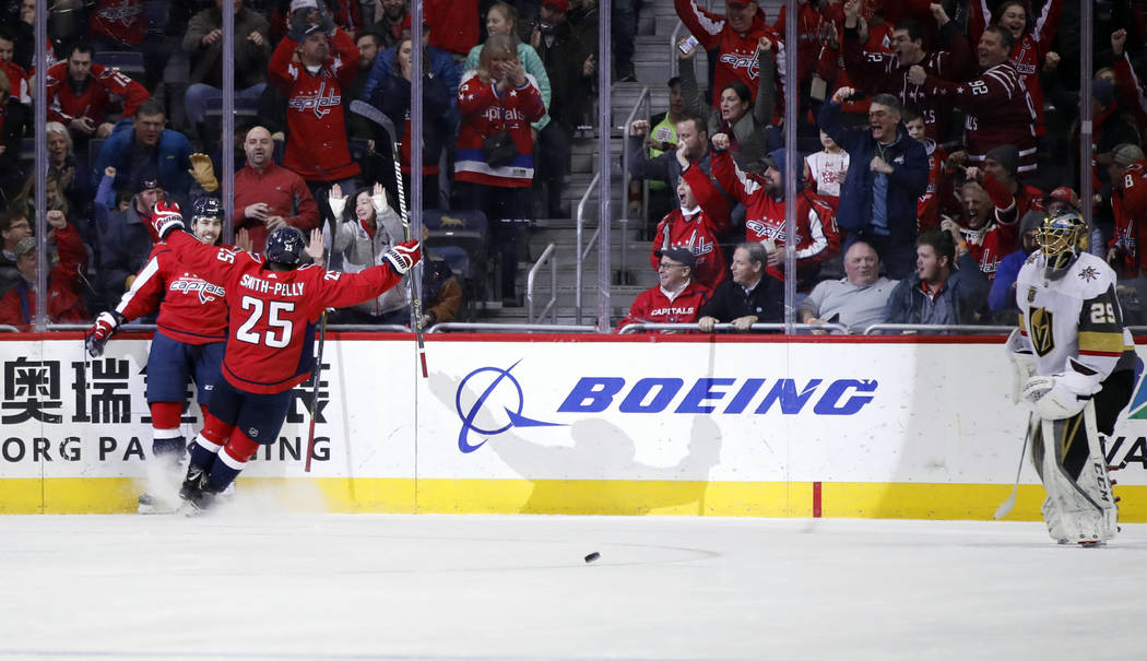 Washington Capitals center Chandler Stephenson (18) and right wing Devante Smith-Pelly (25) celebrate a goal past Vegas Golden Knights goaltender Marc-Andre Fleury (29) in the first period of an N ...