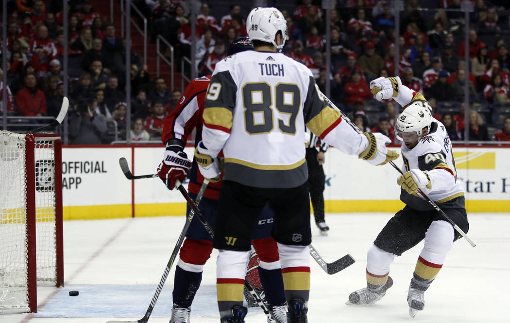 Vegas Golden Knights center Ryan Carpenter (40) celebrates his goal with right wing Alex Tuch (89) nearby in the first period of an NHL hockey game against the Washington Capitals, Sunday, Feb. 4 ...
