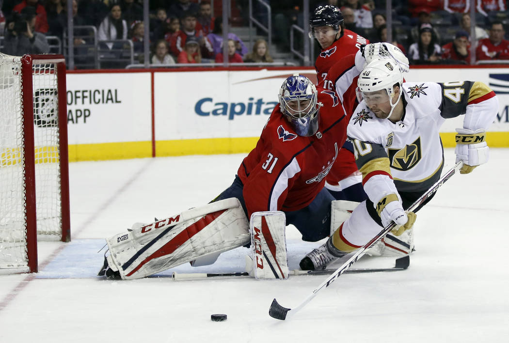 Vegas Golden Knights center Ryan Carpenter (40) lunges to shoot the puck as  Washington 4ee8d148e10