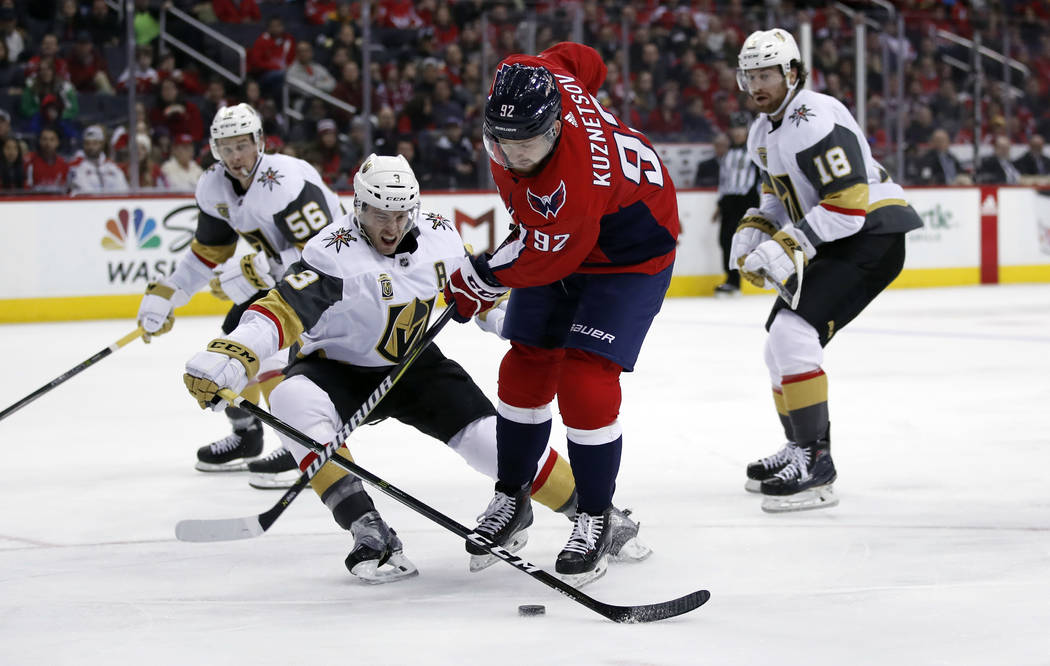 Washington Capitals center Evgeny Kuznetsov (92), from Russia, attempts a shot as Vegas Golden Knights defenseman Brayden McNabb (3) defends in the second period of an NHL hockey game, Sunday, Feb ...