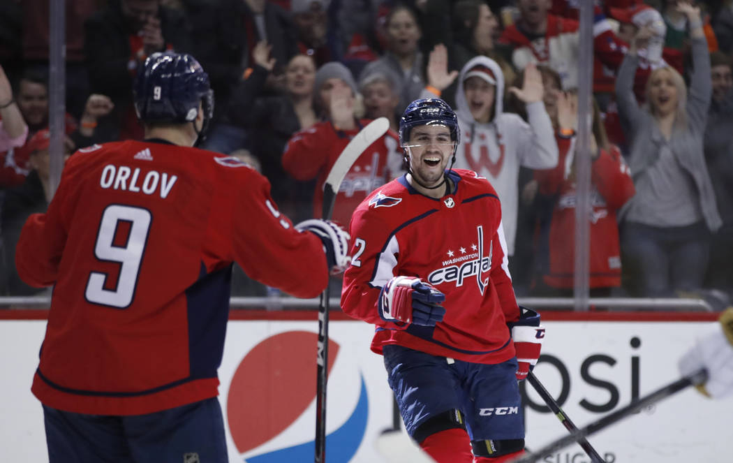 Washington Capitals defenseman Matt Niskanen, right, celebrates his goal with defenseman Dmitry Orlov (9), from Russia, in the second period of an NHL hockey game against the Vegas Golden Knights, ...