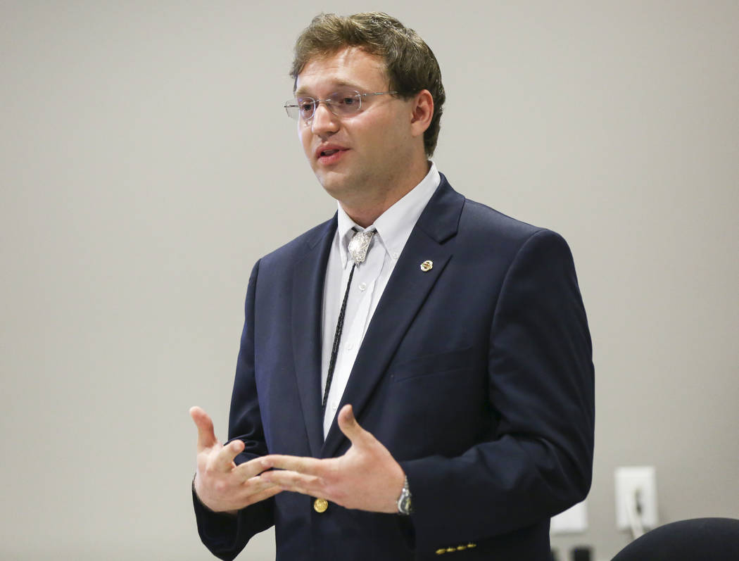 Andrew Coates, candidate for Nevada System of Higher Education Regent District 12, speaks during a panel of candidates running for Nevada's education boards held by the Guinn Center and Hope for N ...