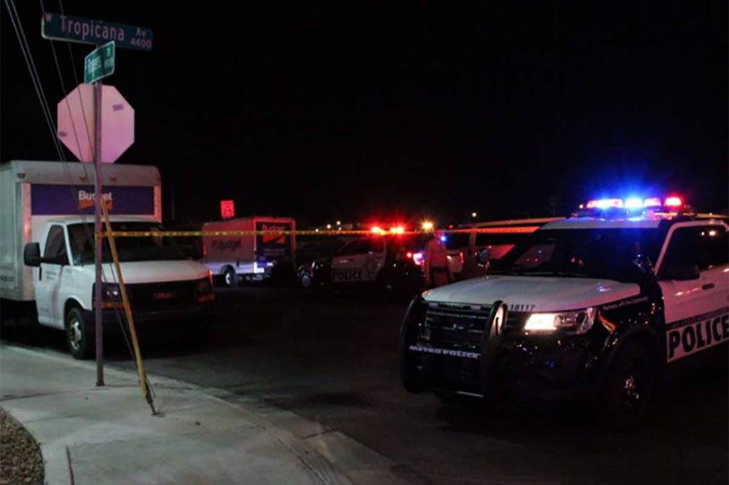 Police block off Rogers Street at Tropicana Avenue on Monday, May 21, 2018, after a man was found shot to death inside his vehicle. (Max Michor/Las Vegas Review-Journal)