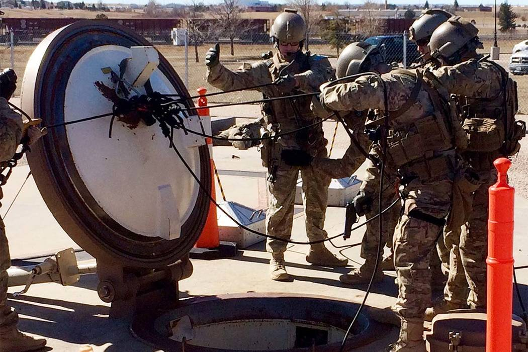 In this February 2016 photo, members of the 790th Missile Security Forces Squadron demonstrate their training for recapturing a Minuteman missile silo after being taken over by an intruder/attacke ...