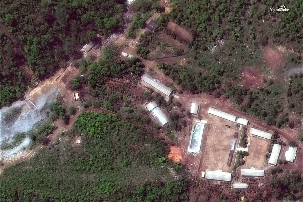 This Wednesday, May 23, 2018 satellite file image provided by DigitalGlobe, shows the Punggye-ri test site in North Korea. North Korea has carried out what it says is the demolition of its nuclear ...