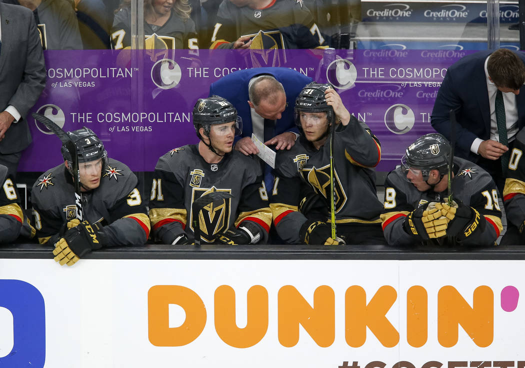 Golden Knights coach Gerard Gallant, center, talks with Jonathan Marchessault (81) and William Karlsson (71) during the second period of Game 1 of an NHL hockey first-round playoff series between ...