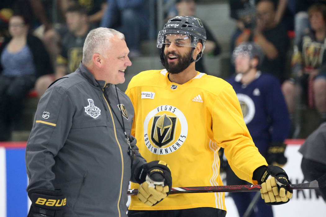 Vegas Golden Knights first assistant coach Mike Kelly, chats with center Pierre-Edouard Bellemare during team practice at City Center Arena on Wednesday, May 23, 2018, in Las Vegas. Bizuayehu Tesf ...