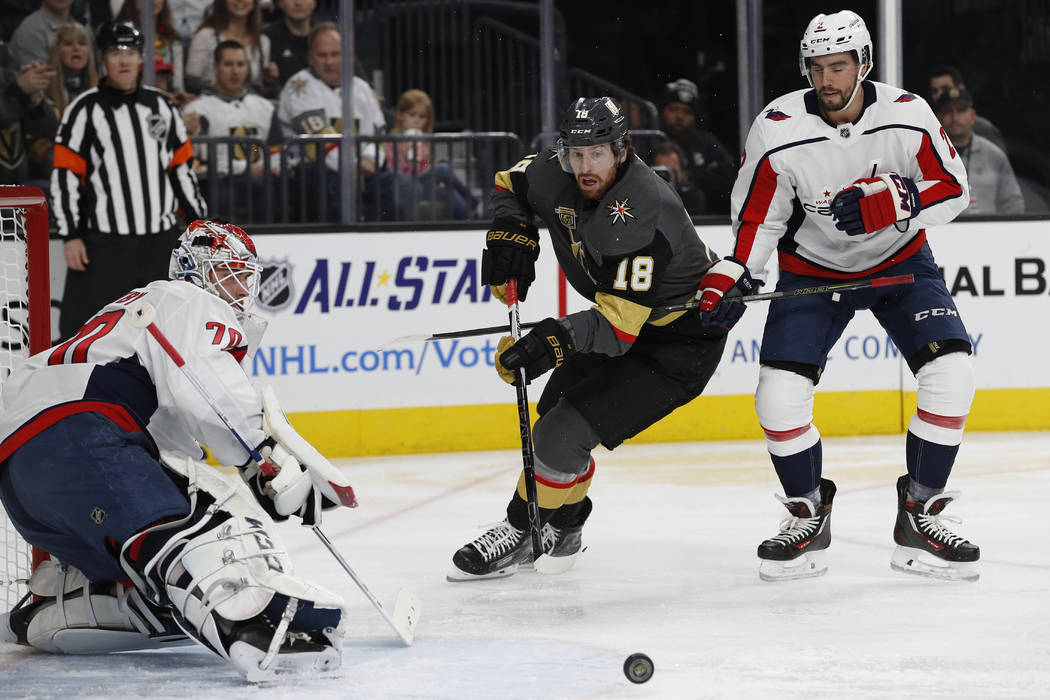 Vegas Golden Knights left wing James Neal (18) attempts a shot on Washington Capitals goalie Braden Holtby during the first period of an NHL hockey game Saturday, Dec. 23, 2017, in Las Vegas. (AP ...