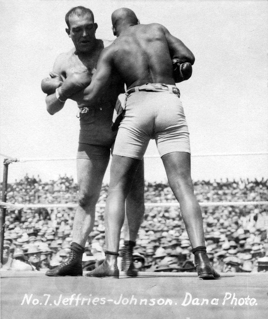 """FILE - In this July 4, 1910 file photo, provided by the Nevada Historical Society, Jack Johnson, right, fights """"Great White Hope"""" Jim Jeffries during a boxing match in Reno, Nev. A cent ..."""