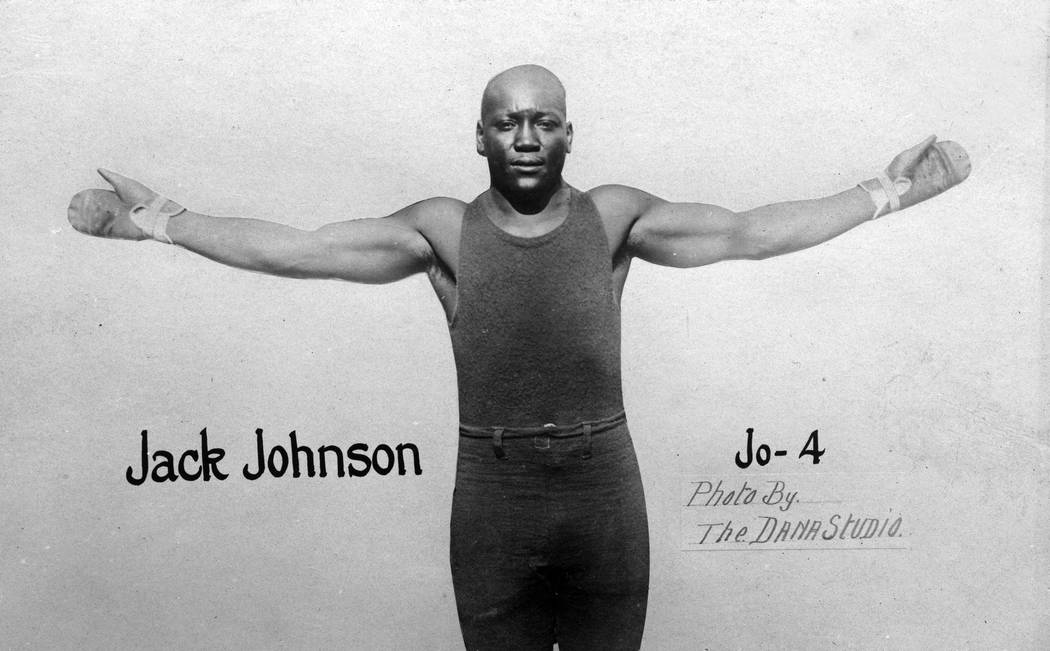 FILE*** In this photo taken in 1910 and provided by the Nevada Historical Society, Jack Johnson is seen in a photo postcard by Dana Studio. A century ago Johnson reached the pinnacle of his caree ...