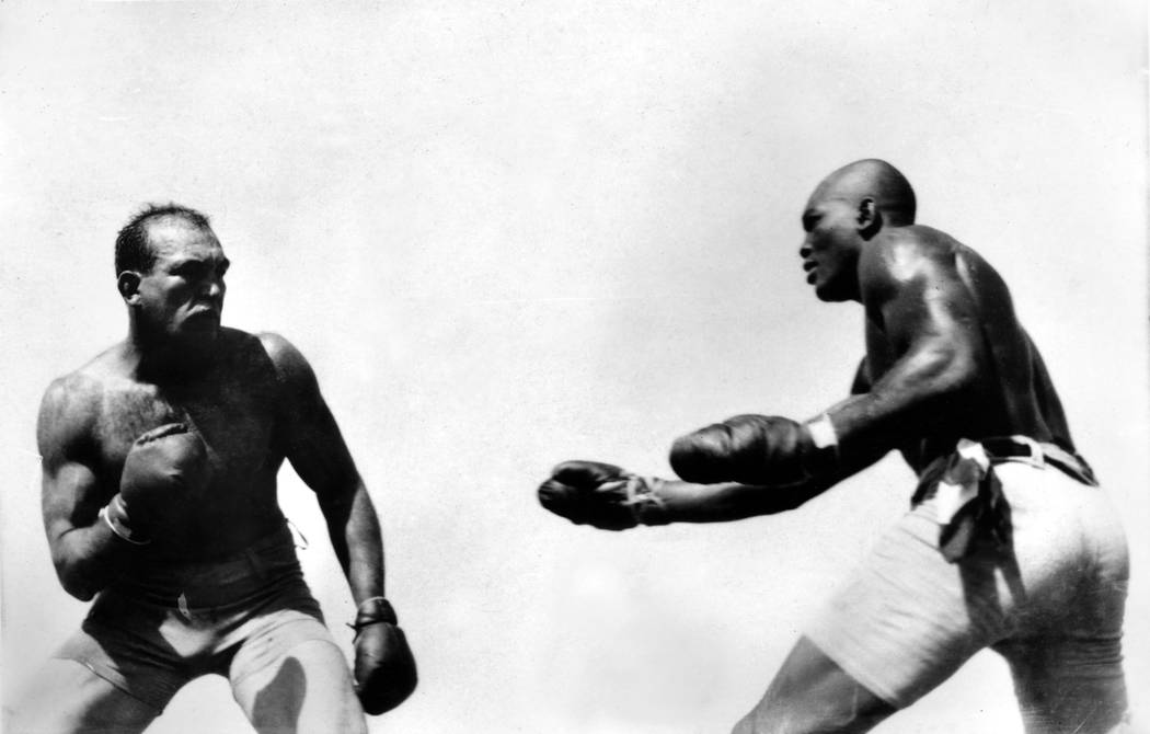 """In this photo taken July 4, 1910 and provided by the Nevada Historical Society, Jack Johnson, right, fights """"Great White Hope"""" Jim Jeffries in Reno Nevada. A century ago Johnson reached ..."""