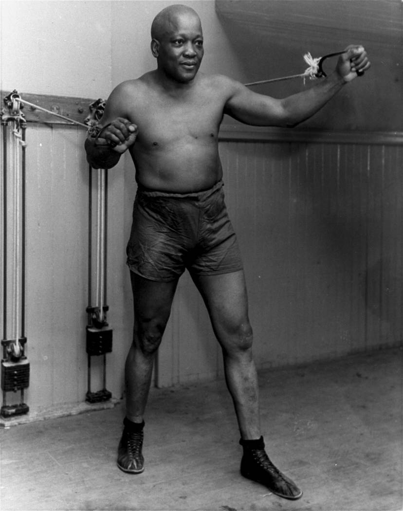 FILE - In this 1932 file photo, boxer Jack Johnson work out in New York City. President Donald Trump on Thursday, May 24, 2018, granted a rare posthumous pardon to boxing's first black heavyweight ...