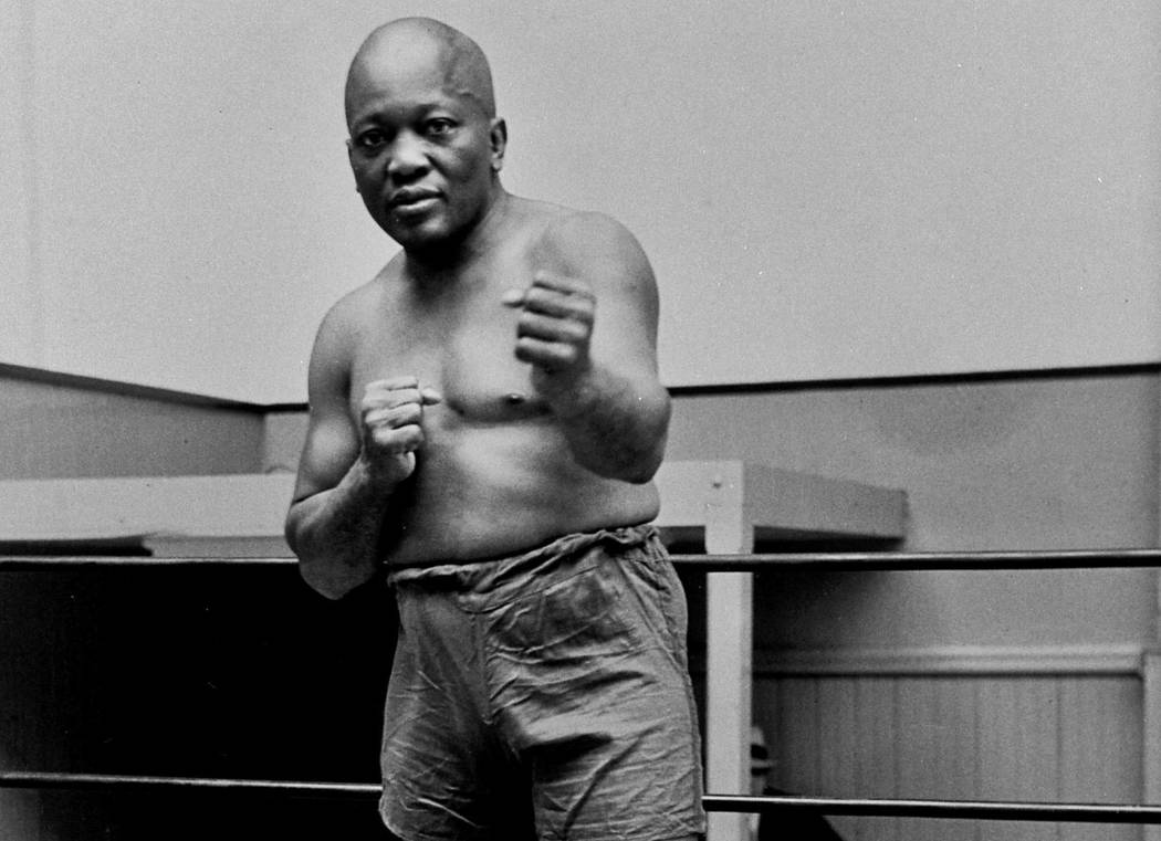 FILE - In this 1932 file photo, boxer Jack Johnson, the first black world heavyweight champion, poses in New York City. President Donald Trump on Thursday, May 24, 2018, granted a rare posthumous ...