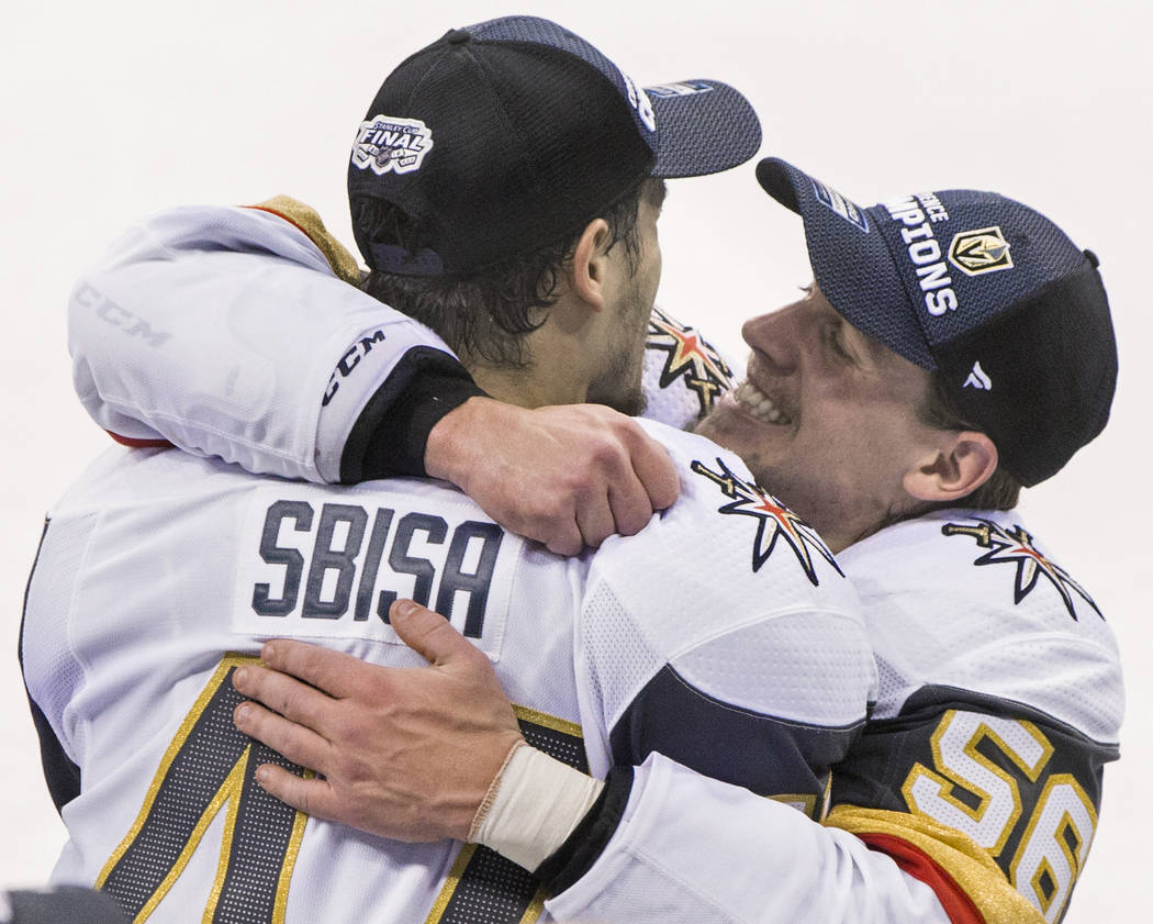 Golden Knights left wing Erik Haula (56) hugs teammate Luca Sbisa (47) after Las Vegas beat the Winnipeg Jets 2-1 to advance to the Stanley Cup Finals on Sunday, May 20, 2018, at Bell MTS Place, i ...