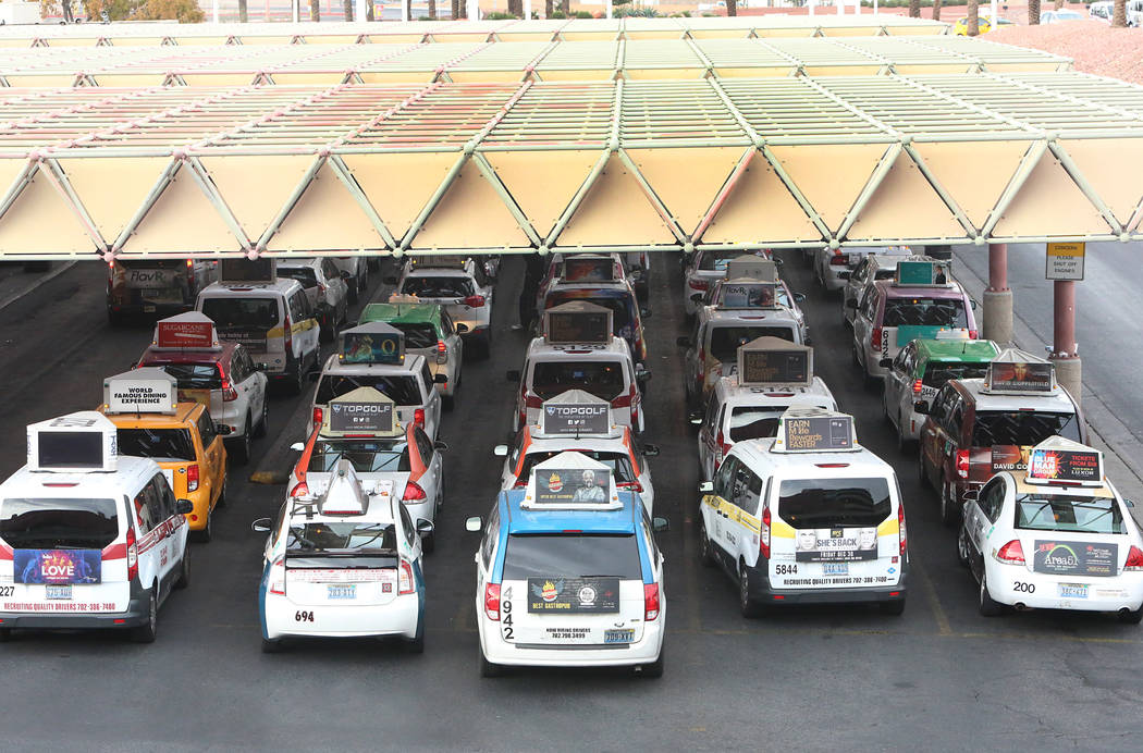 Taxis line up at McCarran Airport. (Bizuayehu Tesfaye/Las Vegas Review-Journal)@bizutesfaye