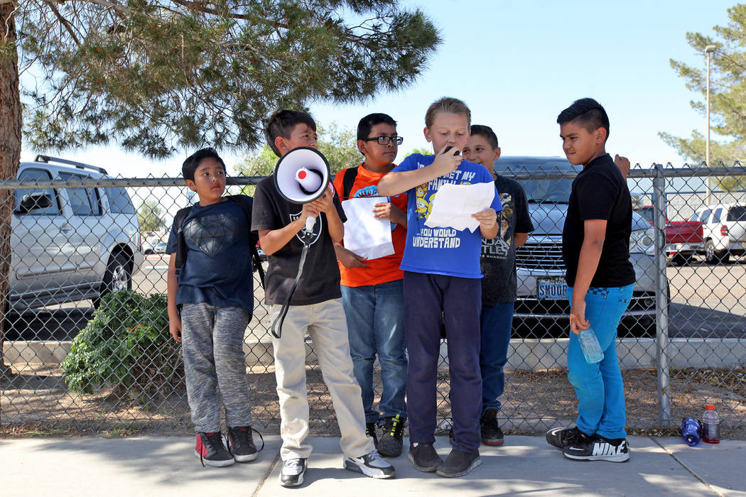 Ryan Brady, 10, speaks about grievances over CCSD budget cuts and other issues as Diego Moreno, 10, from left, Adrian Hinojosa, 9, Benjamin Mijarez, 10, Isaac Cordova, 10, and Andy Gonzales, 10, l ...