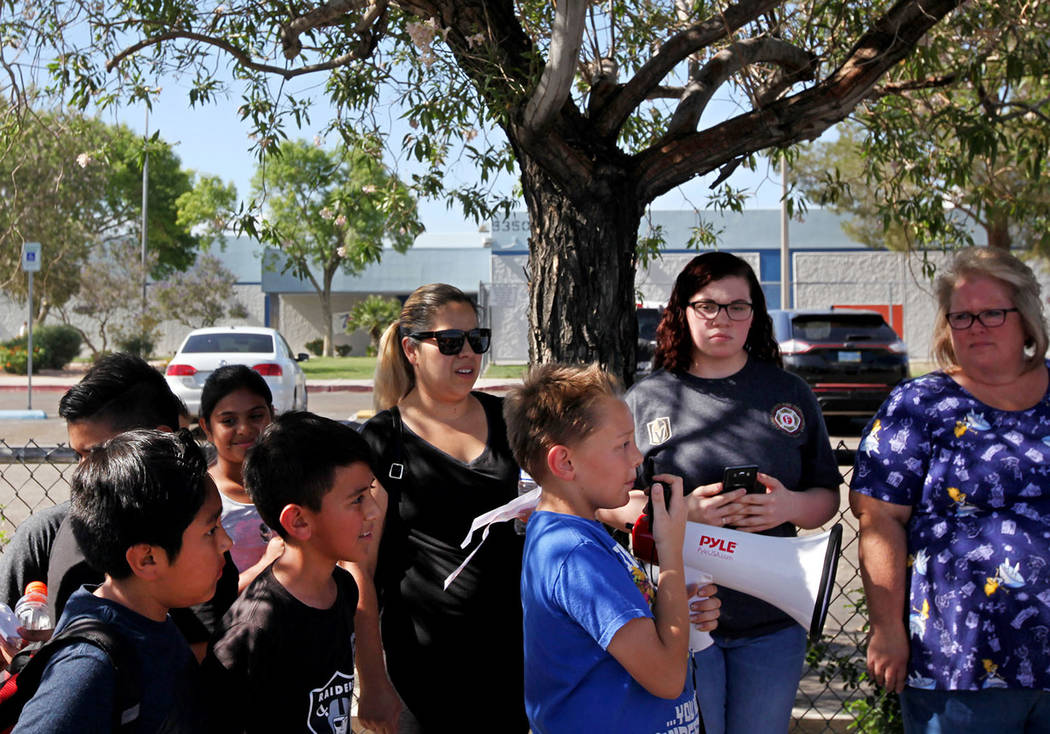 Ryan Brady, 10, speaks about grievances over CCSD budget cuts and other issues as students and parents listen during a town hall outside of Stanford Elementary School in Las Vegas, Wednesday, May ...