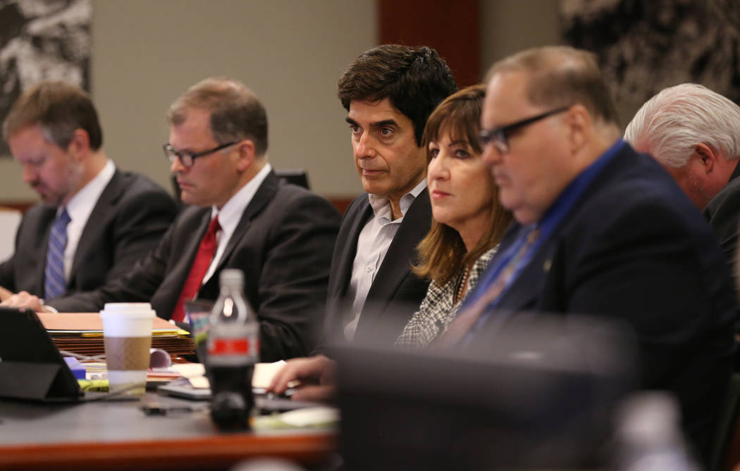 David Copperfield, center, listens to closing arguments during his civil trial at the Regional Justice Center in Las Vegas Thursday, May 24, 2018. A British tourist said he was injured during a ma ...