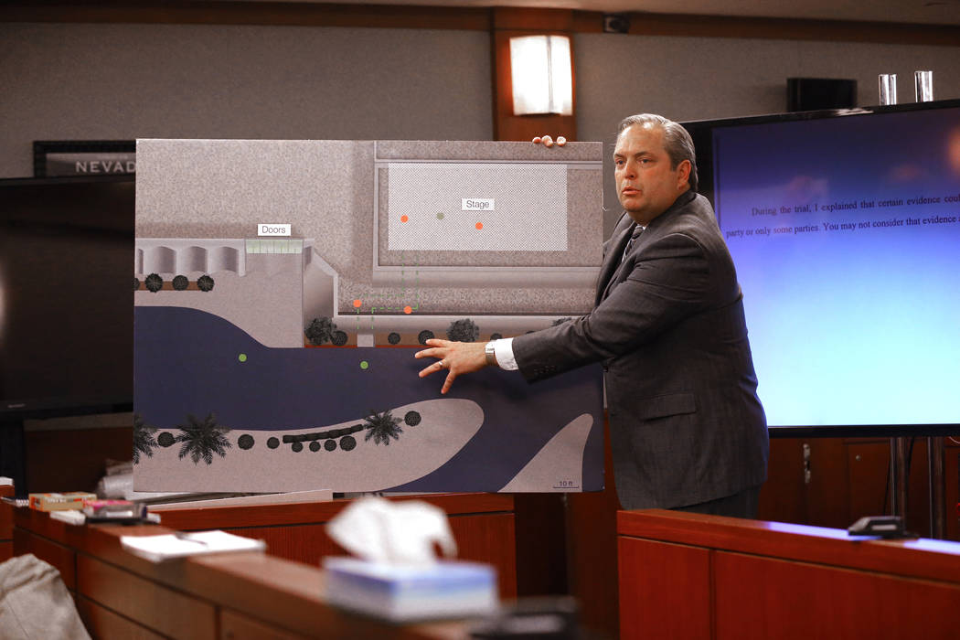 MGM attorney Jerry Popovich shows a photo of the path the plaintiff took during closing arguments at the Regional Justice Center in Las Vegas Thursday, May 24, 2018, in the civil trial involving m ...