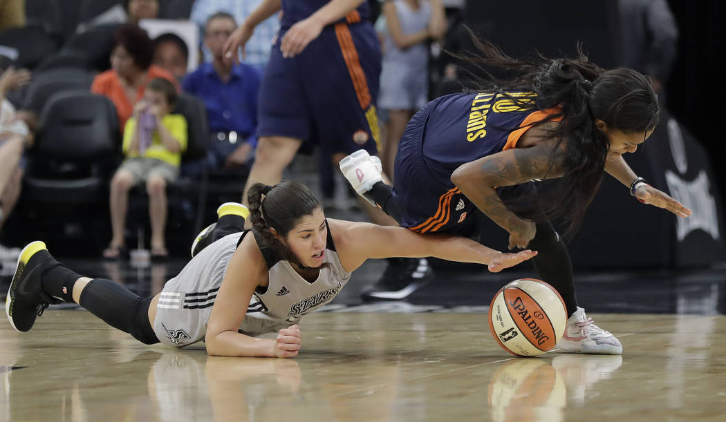 San Antonio Stars guard Kelsey Plum, left, and Connecticut Sun guard Courtney Williams, right, chase a loose ball during the second half of a WNBA basketball game, Wednesday, July 5, 2017, in San ...